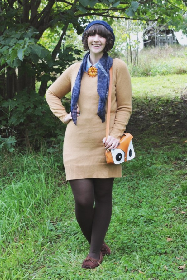 Outfit: Camel sweater dress, blue and orange accessories, fox purse.