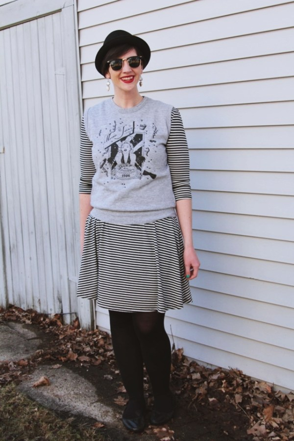 Outfit: Striped dress, gray Marilyn Monroe sweater vest, red lipstick.