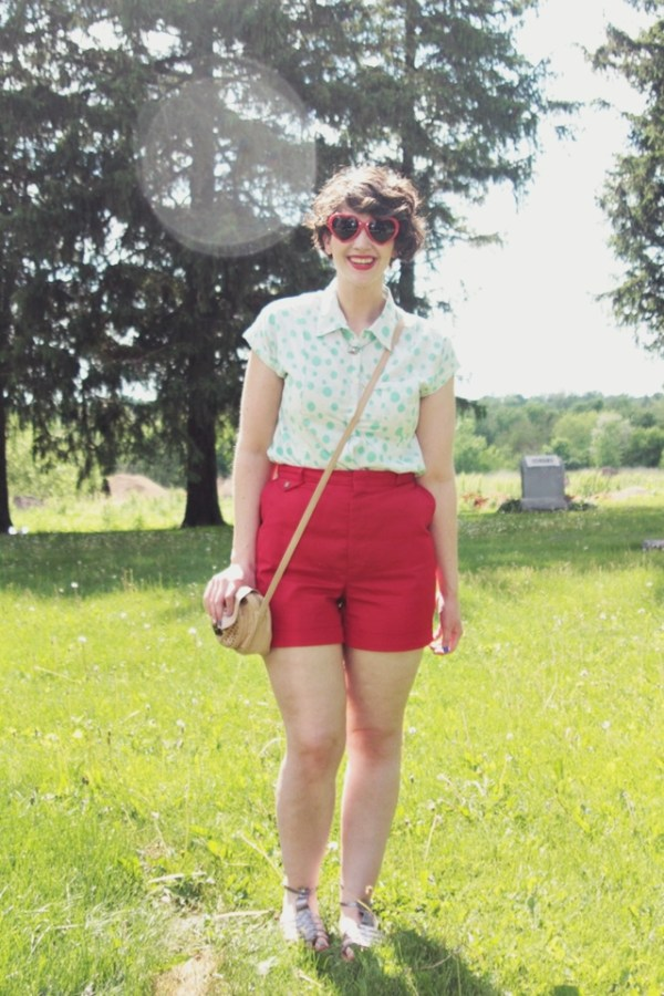 Outfit: Teal polka dot top, red high waisted short, heart sunglasses.