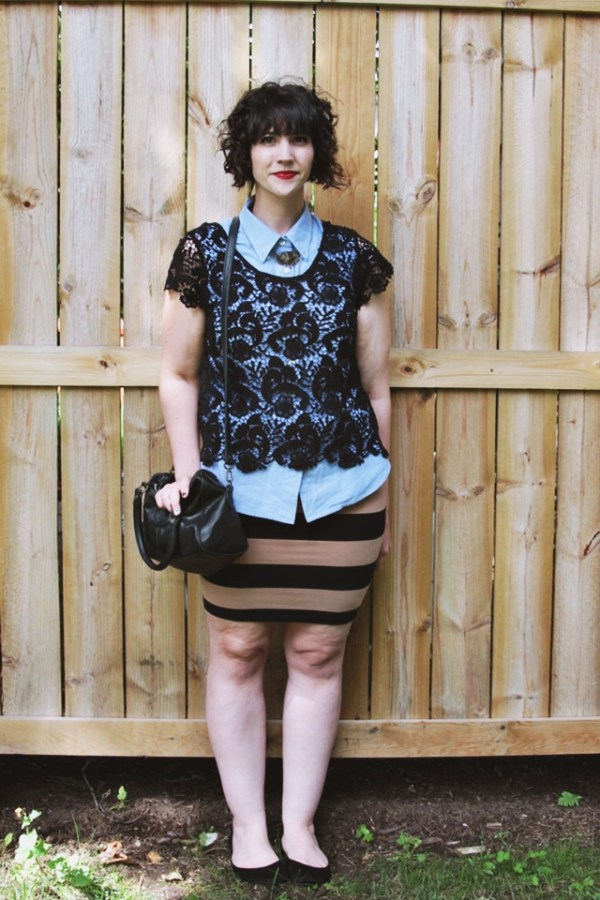 Outfit: Black and tan striped skirt, black lace top, red lipstick.