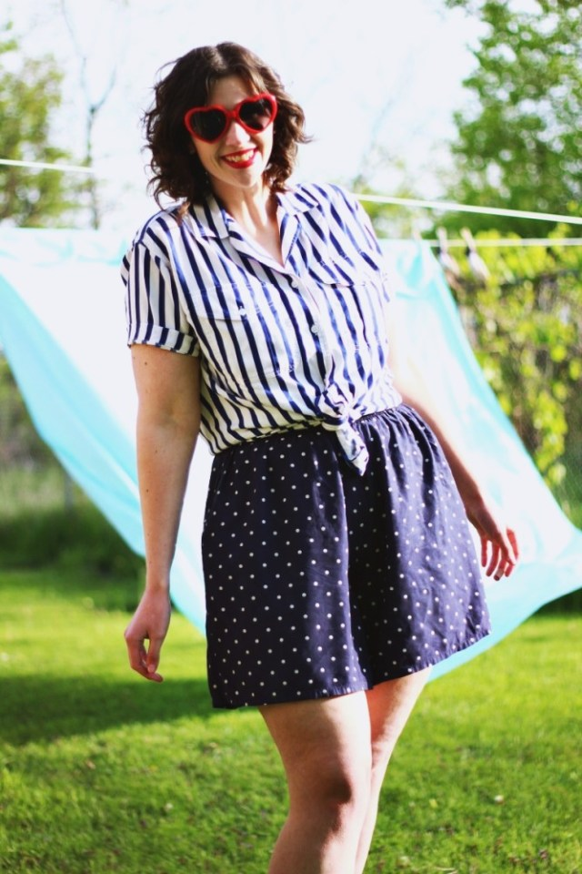 Outfit mixing striped shirt, polka dotted shorts and red heart sunglasses. Sunny outdoor photos with a bed sheet!