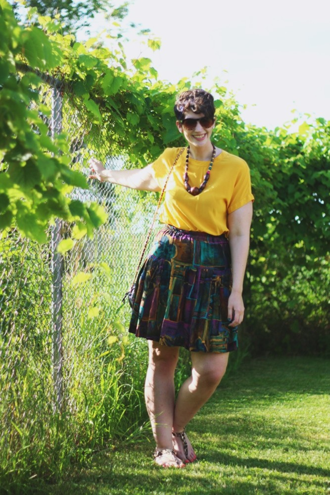 the outfit repeater hannah rupp yellow blouse multi-color skirt thrifted quilted purse beaded necklace