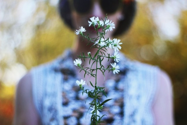 White weeds stand out in front of a 1970s inspired outfit