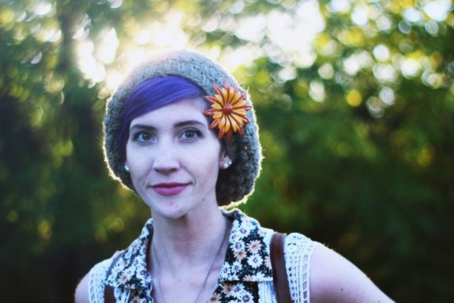 1970s Inspired Outfit: Floral blouse, slouchy green hat, vintage orange flower brooch, purple hair