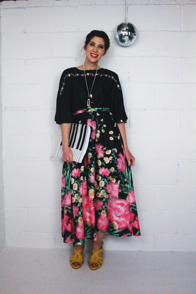1970's inspired outfit: black floral maxi dress, yellow stacked heels, hot pink lipstick, vintage Monet necklace, disco ball