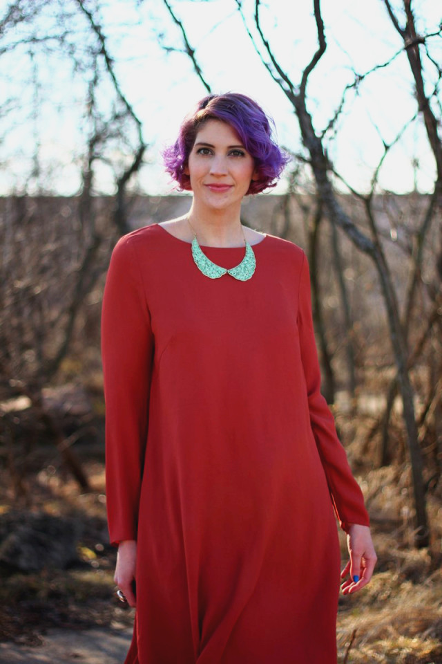 1960's fashion inspired by the movie Rosemary's Baby: burnt orange dress, blue peter pan collar necklace, curly purple hair, mod makeup