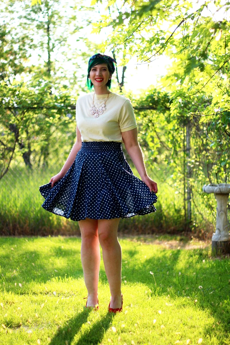 Outfit: primary colors, yellow t-shirt, navy blue polka dot skirt, floral headscarf, flower bib necklace, red lipstick, red kitten heels