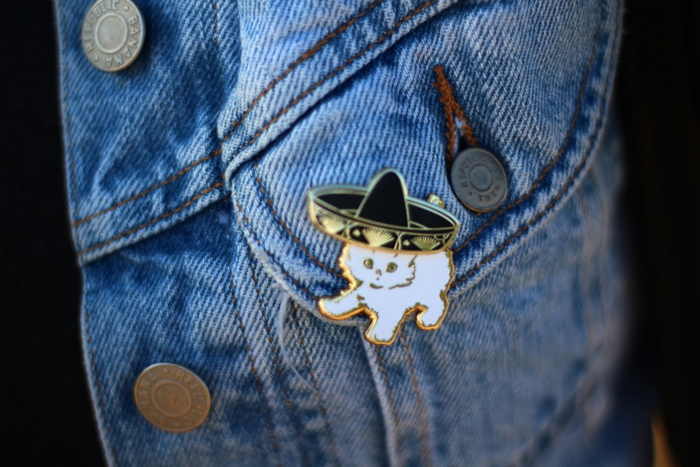 Outfit details: Darling Distraction kitten and sombrero enamel pin flair