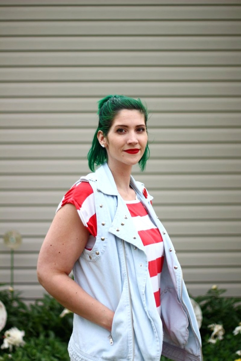 Outfit: red and white striped tunic, denim studded vest, vintage red sunglasses pin, green hair, red lipstick