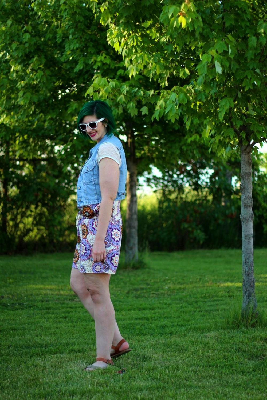 Outfit: purple boho romper overalls, white lace tee, light wash denim vest, green hair, purple lipstick, white sunglasses, Target glitter sandals