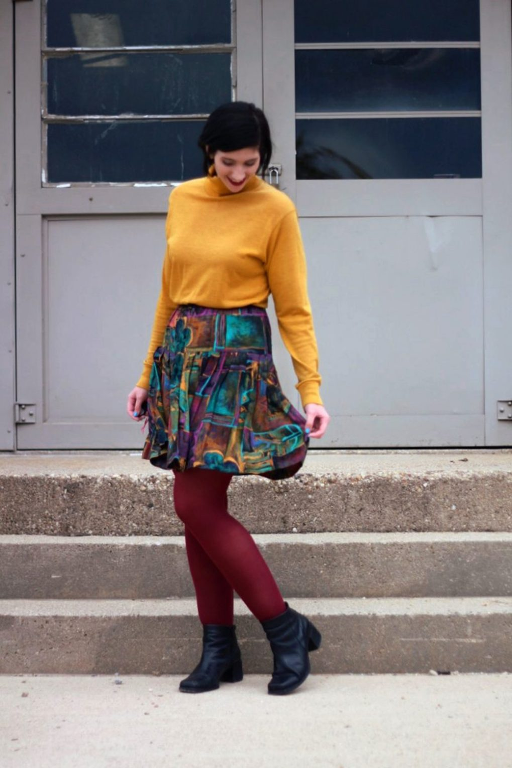 Outfit: mustard yellow turtleneck, multi colored skirt, maroon tights, black booties