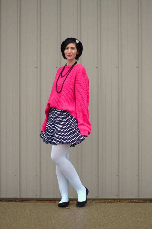 Oversized pink sweater, vintage beaded necklace, black beret, daisy pin, polka dot skirt, mint blue tights, black flats