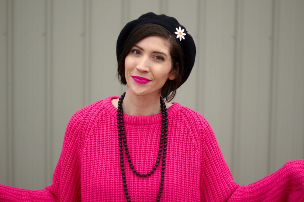 Oversized pink sweater, vintage beaded necklace, black beret, daisy pin