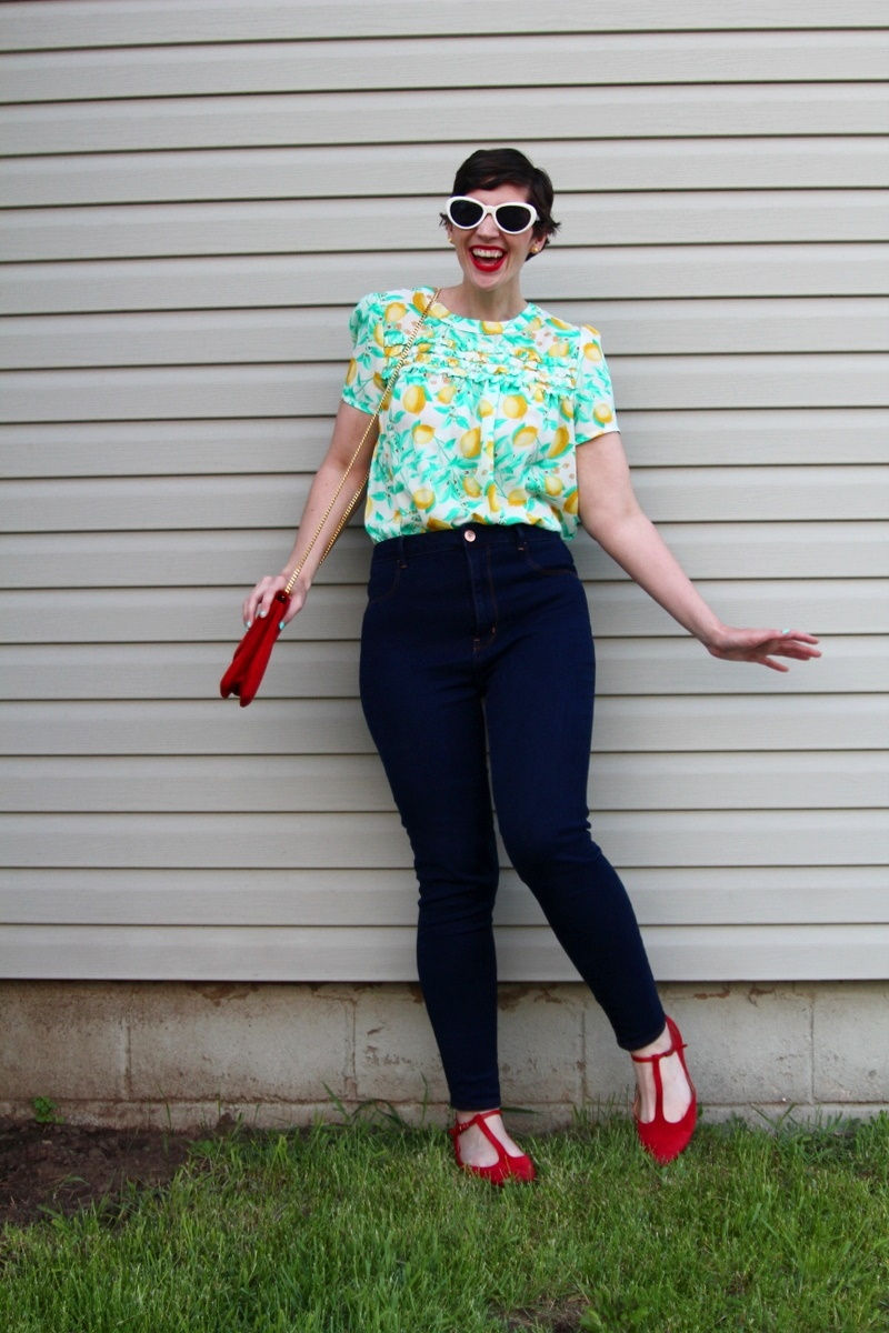 outfit Lemon print blouse, high waisted jeans, red flats, MAC Ruby Woo lipstick, curly pixie haircut, red purse