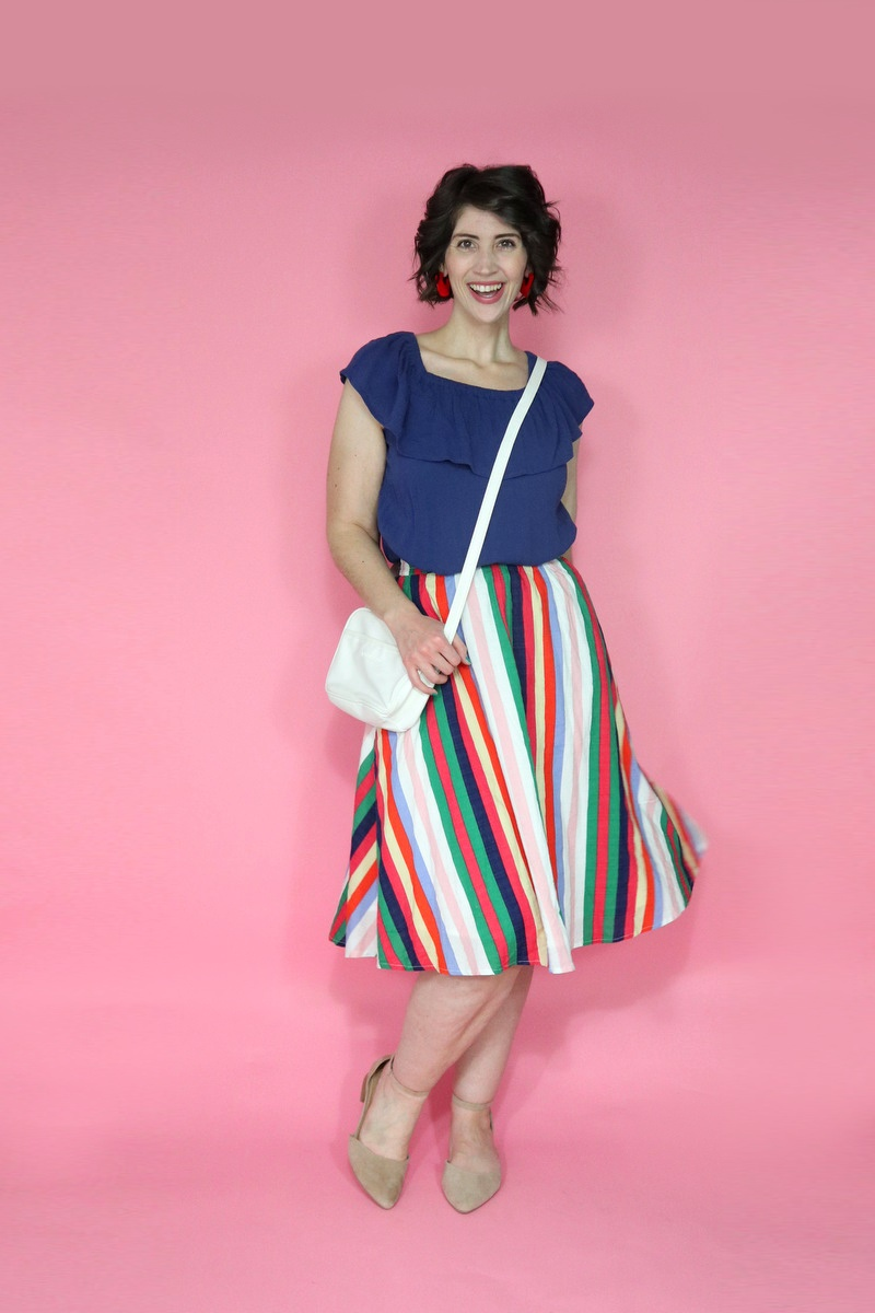 best thrifted clothes rainbow skirt thredup navy blue off the shoulder ruffled blouse white purse outfit