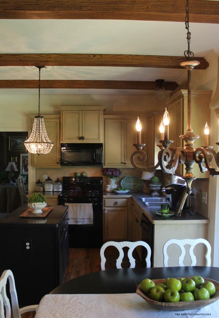chandeliers-in-kitchen-lights-on-az-faux-beams