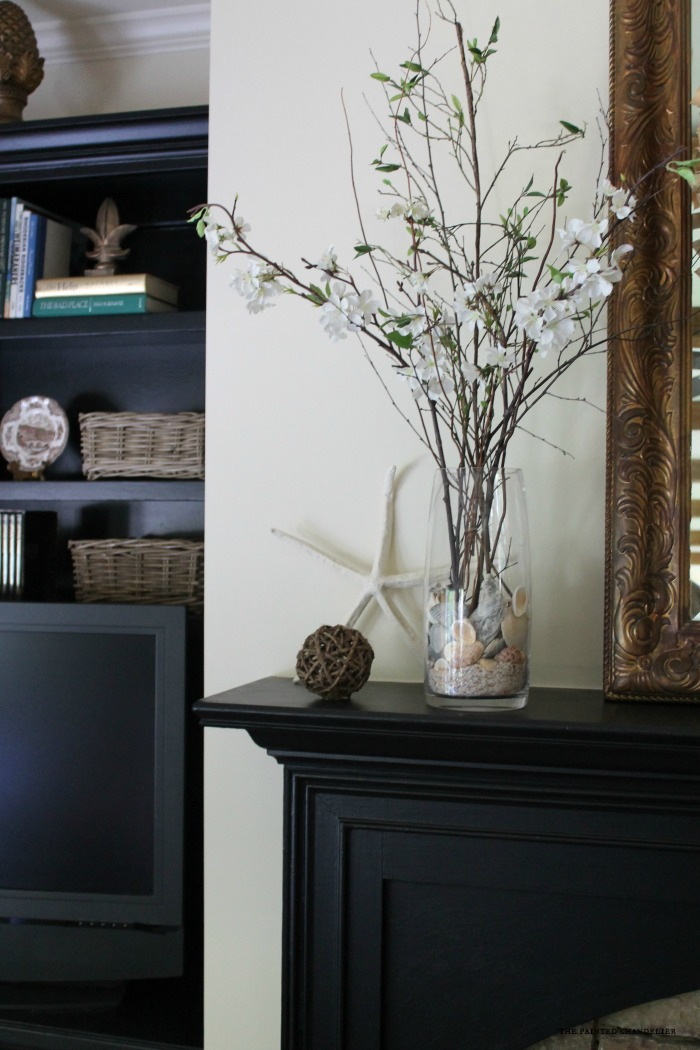 cherry-branches-and-seashells-closeup-mantle