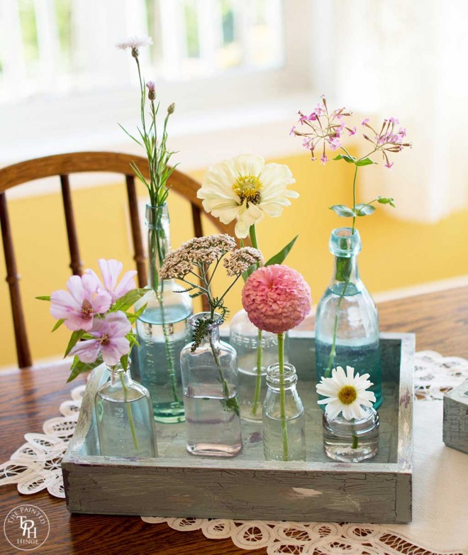 Seasonal Flower Centerpiece Using Old Bottles and Trays