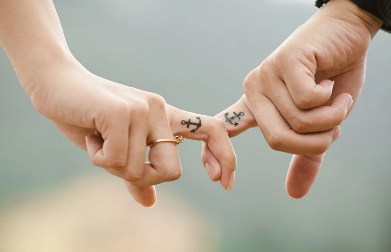 lovers holding fingers