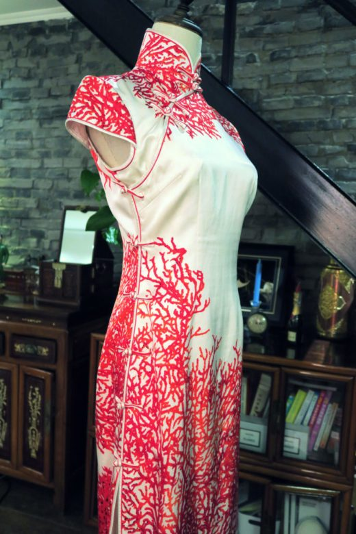Diagonal view of my red and white modern wedding qipao