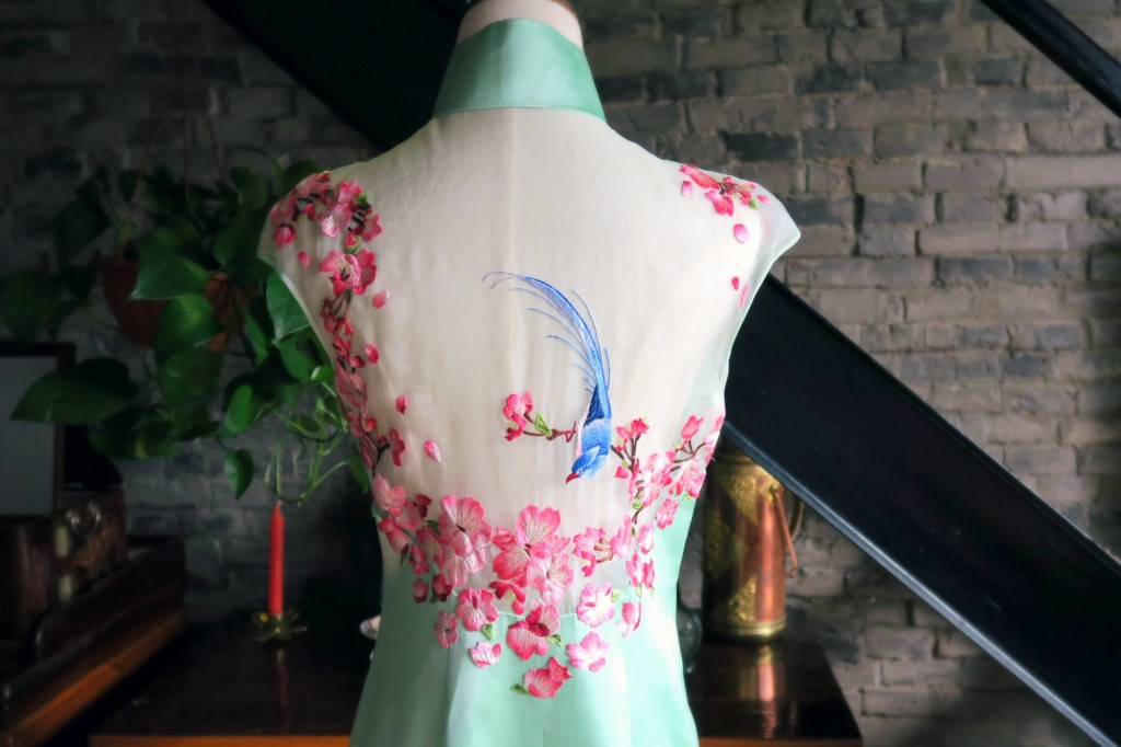 The amazing floral and bird embroidery on the back of my modern wedding qipao.