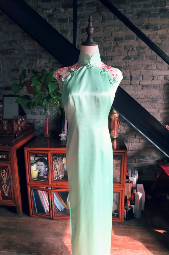A complete view of the front of the dress. Just mint green except for the shoulder highlights.