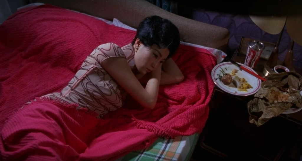 """Obsessed with """"In the Mood for Love""""? The red geometric print qipao (cheongsam) from the complete list of 20 qipaos from the film. Click the link for more -"""