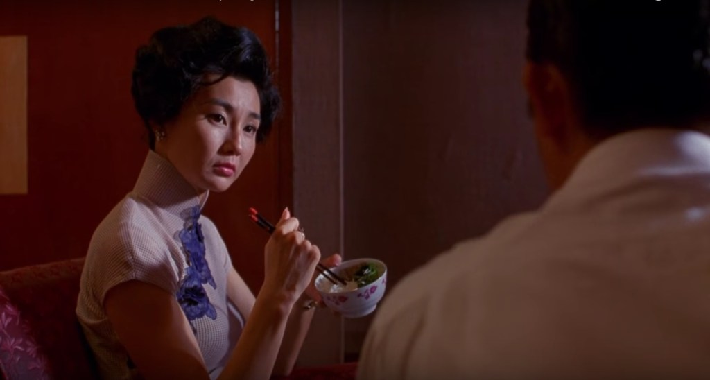 """Obsessed with """"In the Mood for Love""""? The white textured material with blue lace qipao (cheongsam) from the complete list of 20 qipaos from the film. Click the link for more -"""