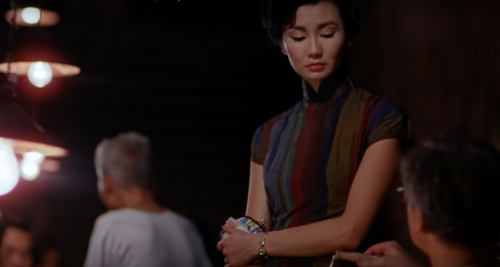 """Obsessed with """"In the Mood for Love""""? The navy-red-yellow vertical stripe qipao (cheongsam) from the complete list of 20 qipaos from the film. Click the link for more -"""