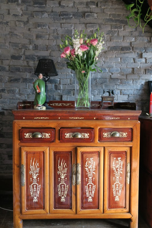Antique Chinese sideboard with wooden inlay