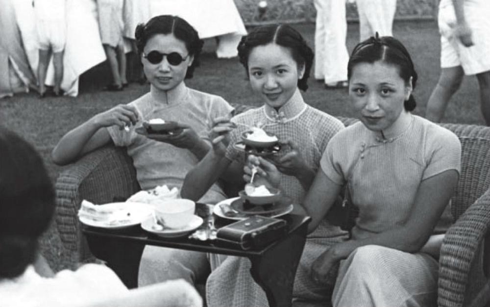 Three women wearing Shanghai-style qipao