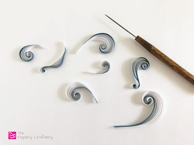 How to Make Quilling Paper Clouds ~ Use paper swirls to create fluffy storm clouds, bright sunset clouds and more! || www.ThePaperyCraftery.com