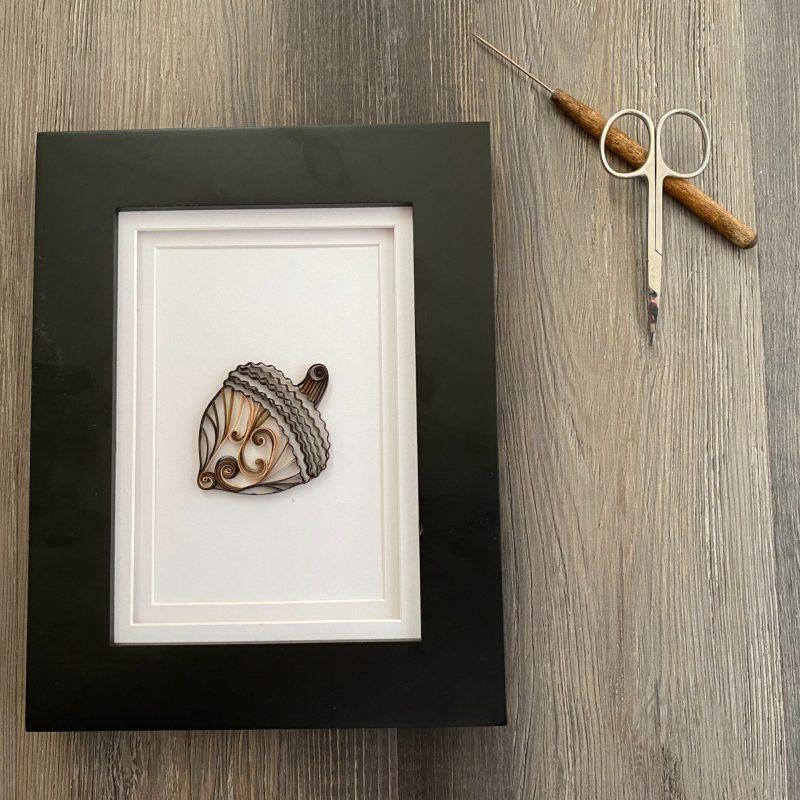 framed brown quilling paper acorn