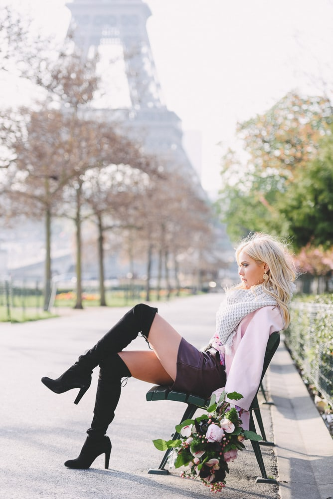 Paris portraits - Solo portrait shot of an attractive blond girl by the Eiffel Tower