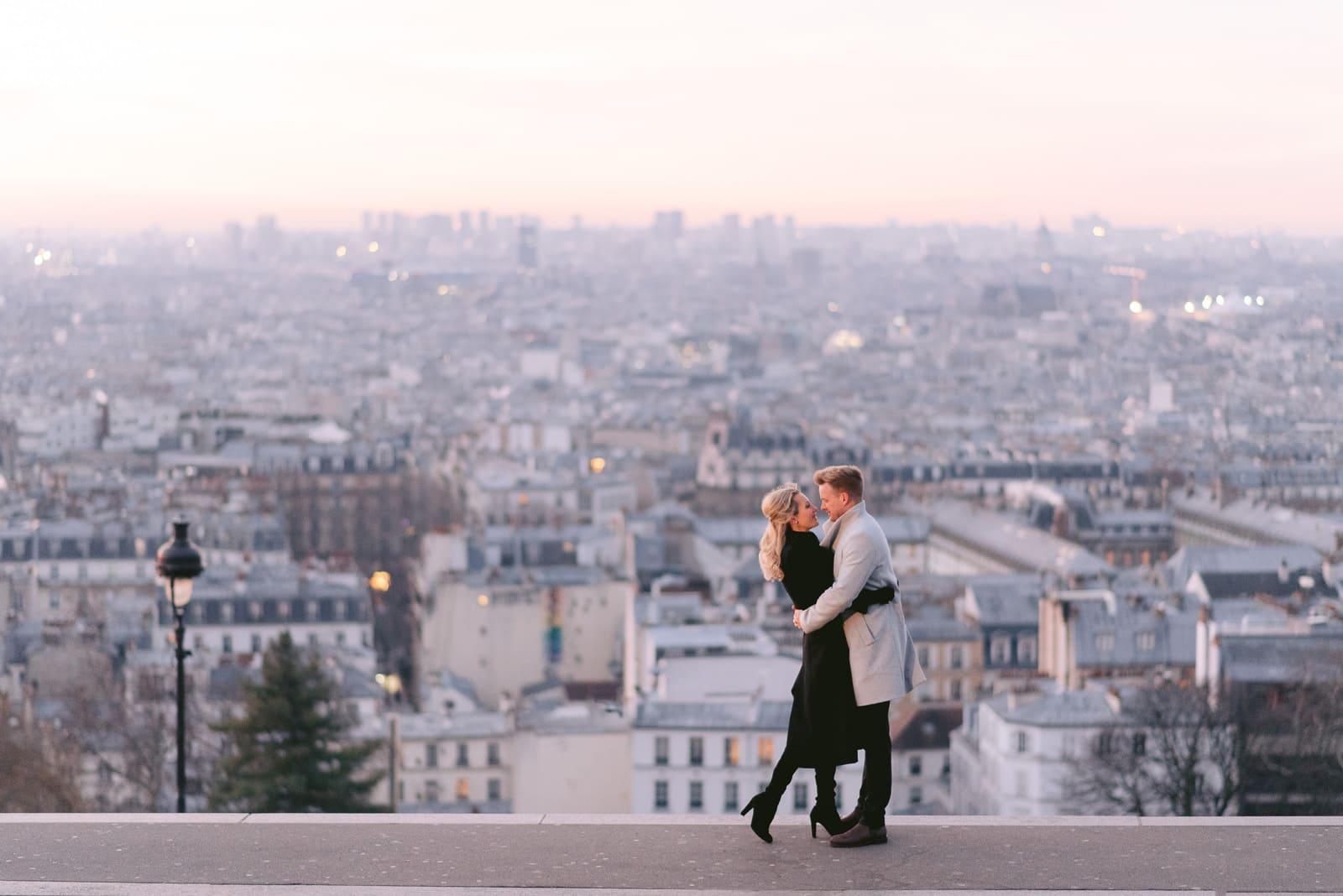 Paris proposal photographer - Engagement photos at Montmartre overlooking the city of Paris