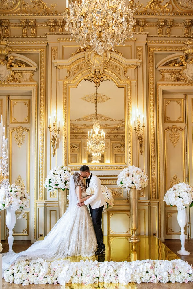 Paris wedding - bride and groom kissing during ceremony at Shangri La hotel in Paris