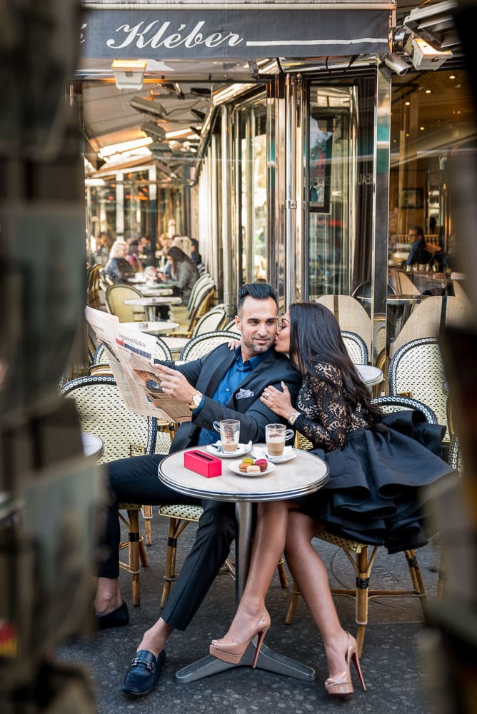 couple photography images of gentleman reading newspaper in a parisian cafe