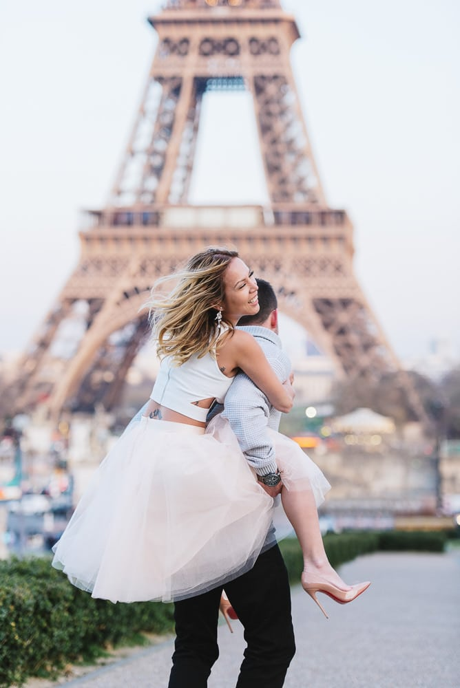 couple portraits photography - gentleman carrying his wife dressed with tutu dress and high heels