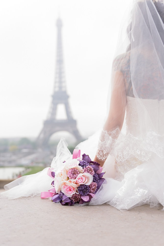 pre wedding photo close up of wedding bouquet at the eiffel tower in paris