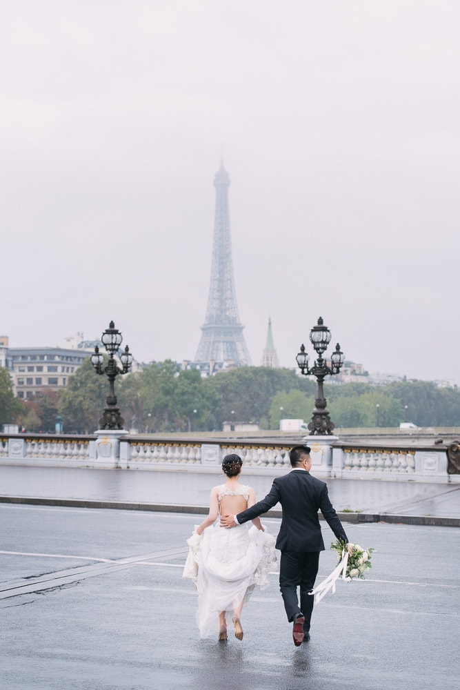 pre wedding photo concept bride and groom running across the street in paris