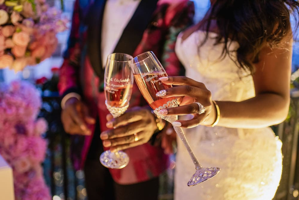 Plaza Athenee Paris Wedding - Bride and groom toasting with personalized champagne glasses