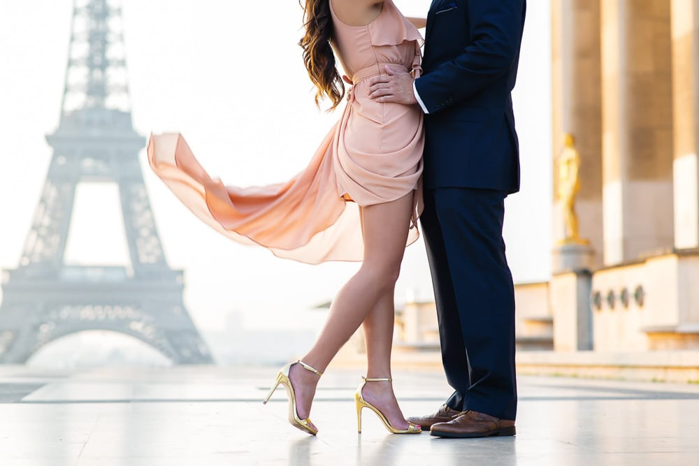 Romantic picture with a flowy dress in front of the Eiffel Tower
