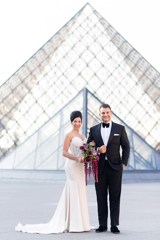 Stylish couple posing for their bride and groom portraits on the day of their Crillon wedding in Paris
