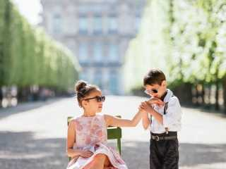 Best couple images – Kid gentleman kissing little girl's hand in the Tuileries Gardens in Paris