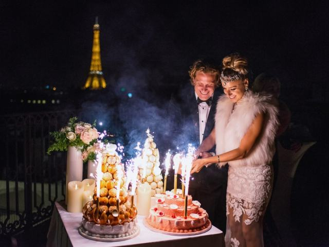 Bride and groom cutting La Duree wedding cake on the rooftop of the peninsula paris