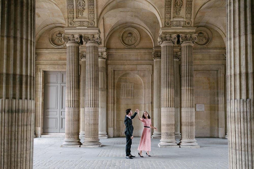 Couple honeymoon in Paris - dancing surrounded by elegant architecture