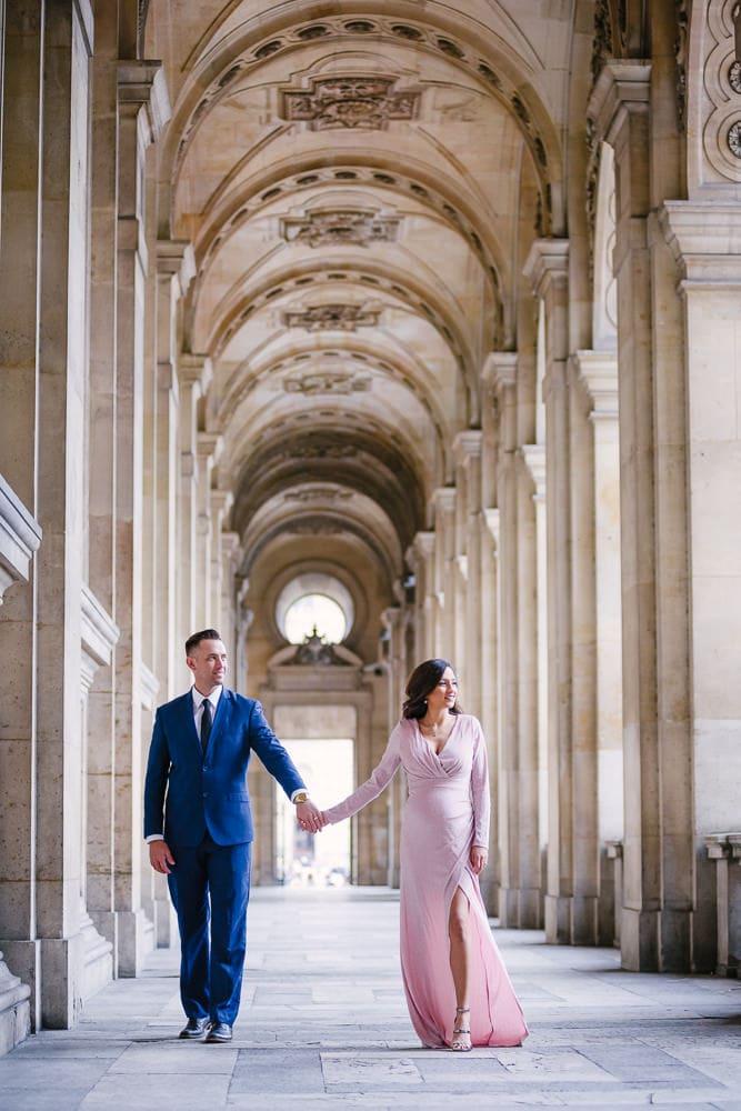 Parisian photographer captures couple walking in Paris surrounded by gorgeous architecture