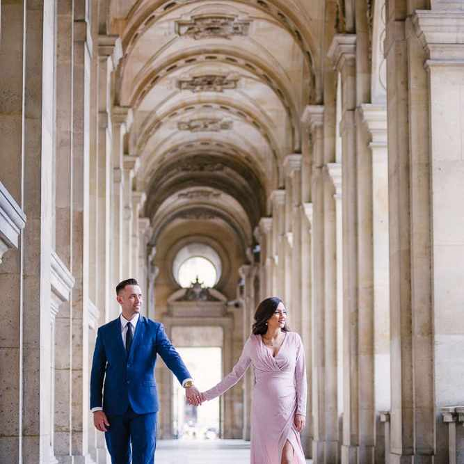 Parisian photographer captures couple walking in Paris surrounded by gorgeous architecture