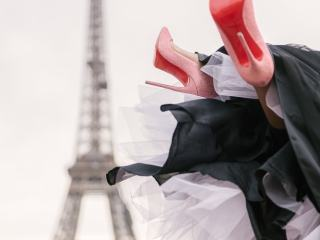 The Paris Photographer signature photo of Christian Louboutin heels in the air in front of the Eiffel Tower