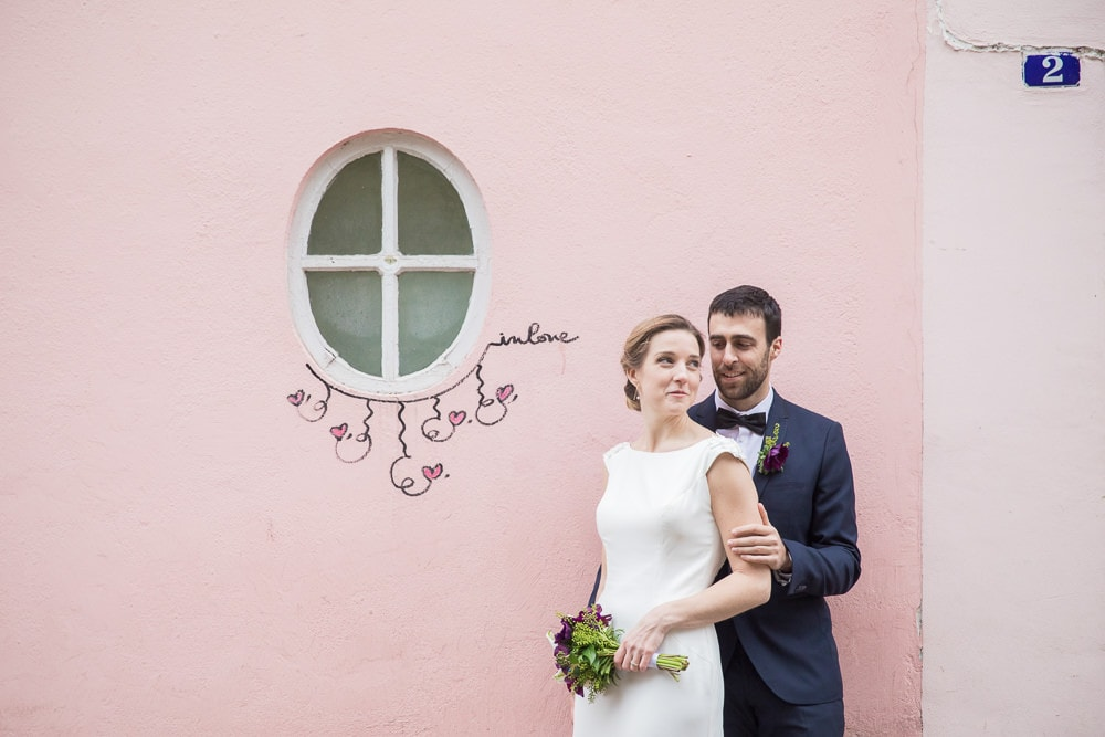 Bride and groom posing at La Maison Rose in Montmartre